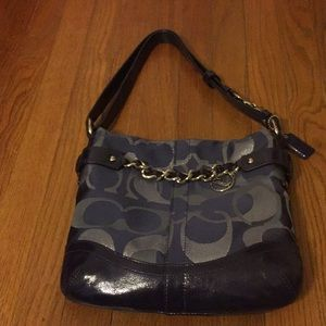 Great condition small coach pocketbook